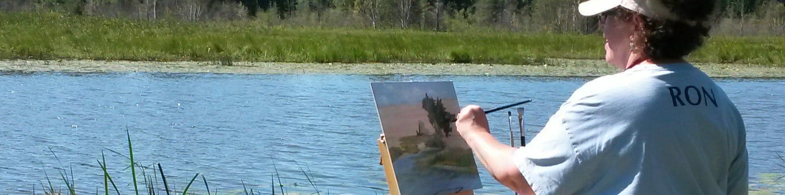 woman painting wetlands